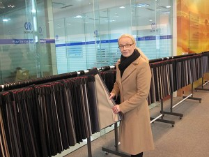Ms. Sirpa Välimaa, TCS (Technical Client Service) Manager of Stora Enso's dissolving pulp production presents textiles made of dissolving pulp from Uimaharju mill.